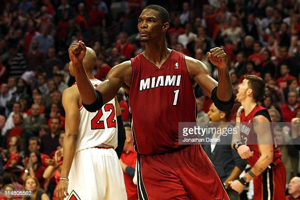 Chris Bosh of the Miami Heat celebrates after the Heat won 8380 against the Chicago Bulls in Game Five of the Eastern Conference Finals during the...