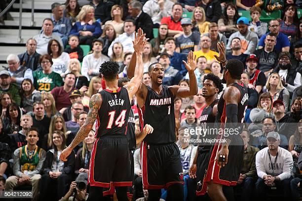Chris Bosh of the Miami Heat celebrates with teammates against the Utah Jazz on January 9 2016 at vivintSmartHome Arena in Salt Lake City Utah NOTE...