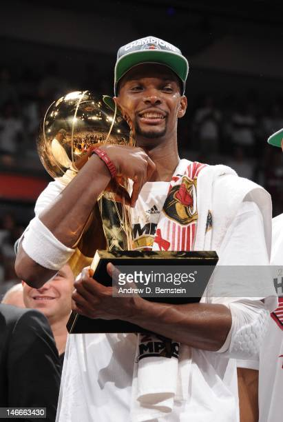 Chris Bosh of the Miami Heat celebrates with the Larry O'Brien Championship trophy after the team's 121106 victory against the Oklahoma City Thunder...