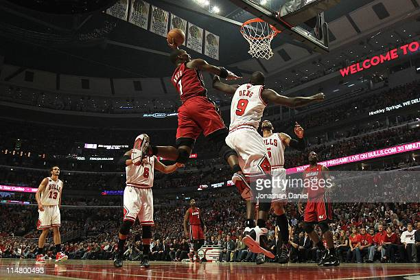 Chris Bosh of the Miami Heat drives for a shot attempt against Luol Deng of the Chicago Bulls in Game Five of the Eastern Conference Finals during...