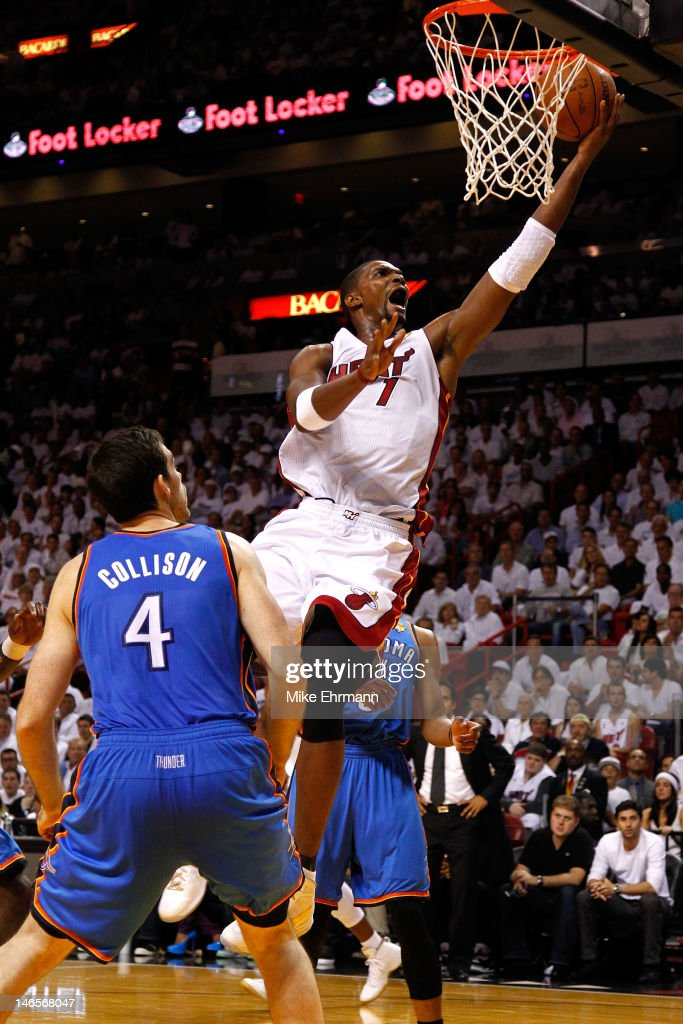 Chris Bosh #1 of the Miami Heat drives for a shot attempt in the first quarter against Nick Collison #4 of the Oklahoma City Thunder in Game Four of the 2012 NBA Finals on June 19, 2012 at American Airlines Arena in Miami, Florida.