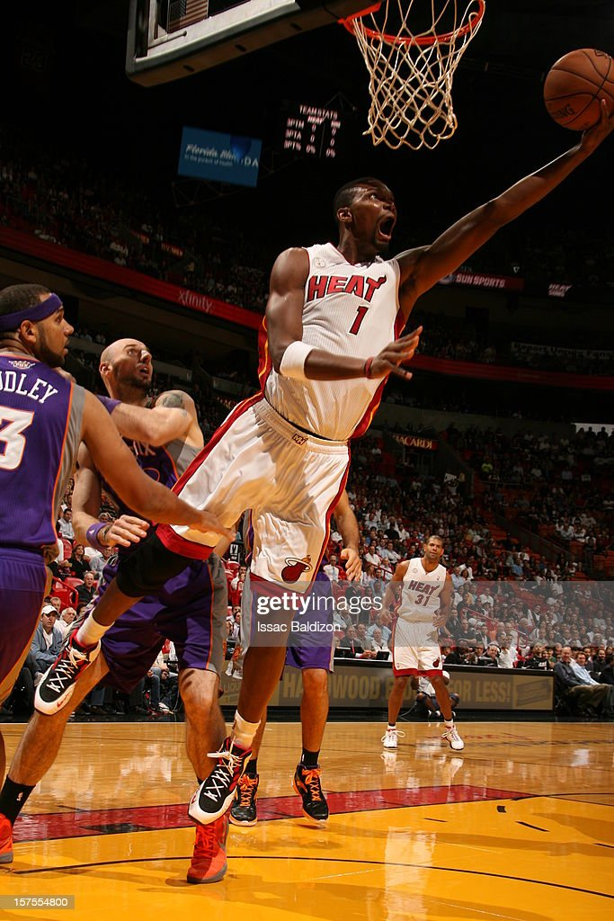 Chris Bosh #1 of the Miami Heat drives to the basket against the Phoenix Suns during a game on November 5, 2012 at American Airlines Arena in Miami, Florida.