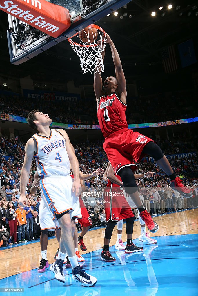 Chris Bosh #1 of the Miami Heat dunks the ball against the Oklahoma City Thunder during an NBA game on February 14, 2013 at the Chesapeake Energy Arena in Oklahoma City, Oklahoma.