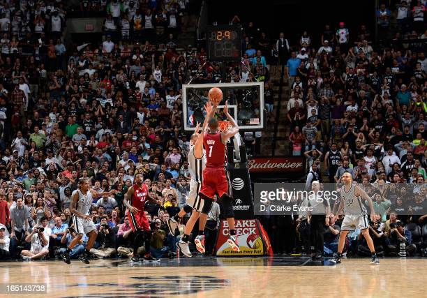 Chris Bosh of the Miami Heat goes for a gamewinning shot during the game between the Miami Heat and the San Antonio Spurs on March 31 2013 at the ATT...