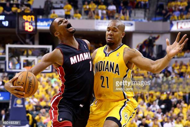 Chris Bosh of the Miami Heat goes to the basket as David West of the Indiana Pacers defends during Game Two of the Eastern Conference Finals of the...