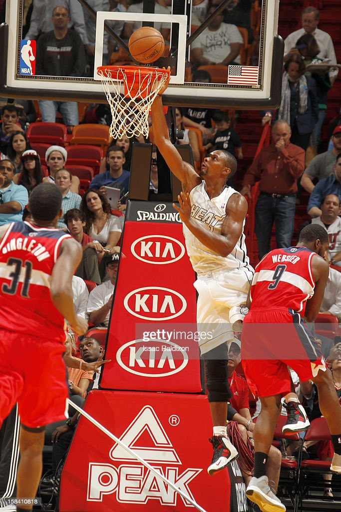 Chris Bosh #1 of the Miami Heat goes to the basket during a game between the Washington Wizards and the Miami Heat on December 15, 2012 at American Airlines Arena in Miami, Florida.