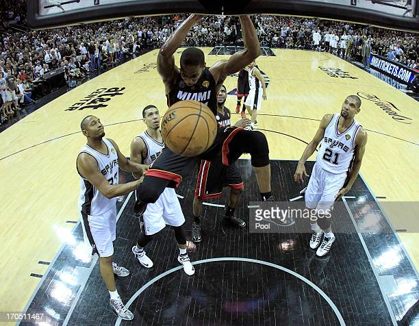 Chris Bosh of the Miami Heat goes up for a dunk but it is after the end of the second quarter against the San Antonio Spurs during Game Four of the...