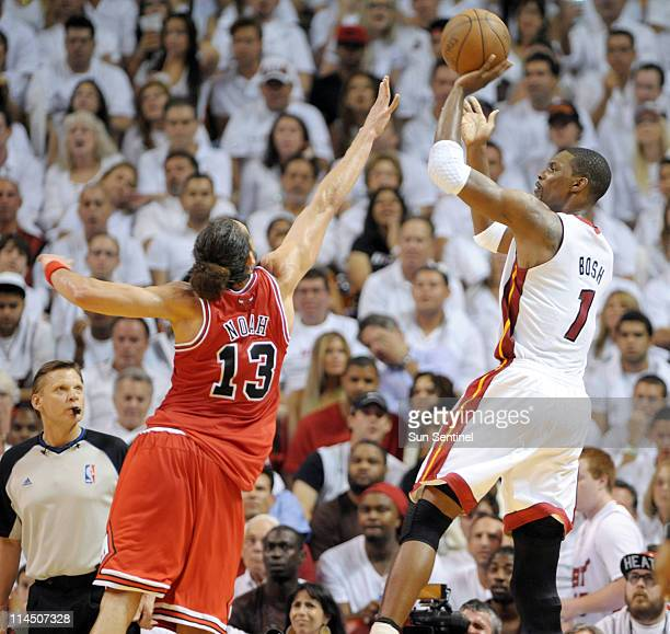 Chris Bosh of the Miami Heat goes up for a shot over Joakim Noah of the Chicago Bulls in the third quarter during Game 3 of the NBA Eastern...