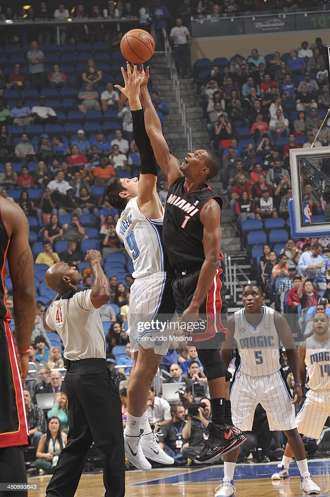 Chris Bosh #1 of the Miami Heat goes up for the opening tip against the Orlando Magic during the game on November 20, 2013 at Amway Center in Orlando, Florida.