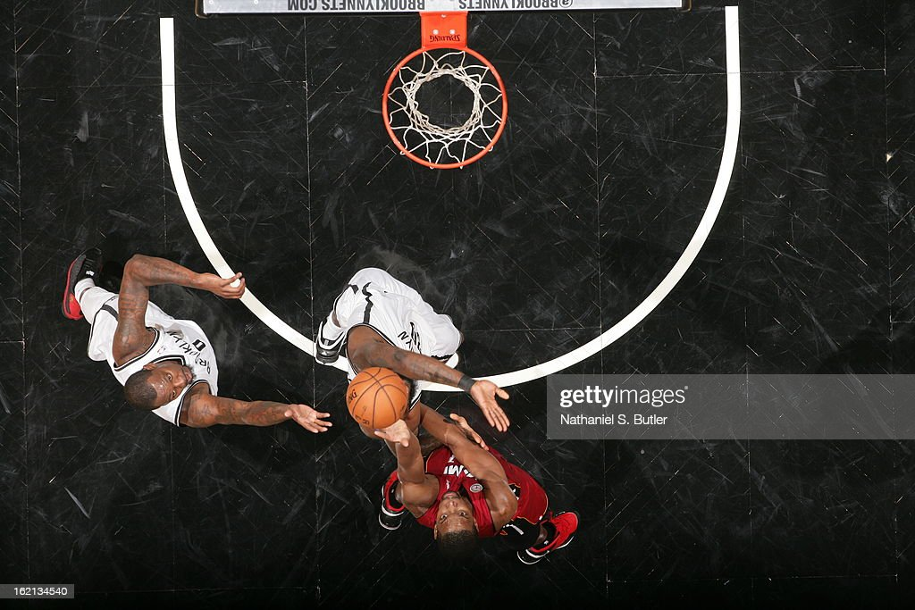 Chris Bosh #1 of the Miami Heat grabs a rebound against the Brooklyn Nets on January 30, 2013 at the Barclays Center in the Brooklyn borough of New York City.