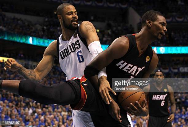 Chris Bosh of the Miami Heat grabs the ball in front of Tyson Chandler of the Dallas Mavericks in the first quarter in Game Five of the 2011 NBA...