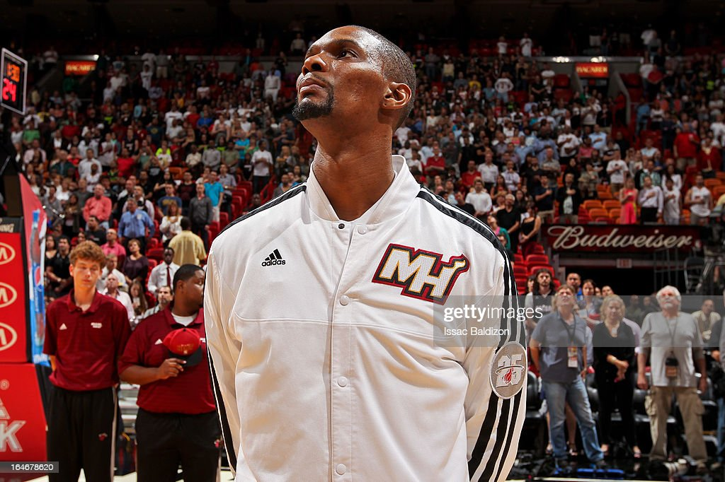 Chris Bosh #1 of the Miami Heat listens to the National Anthem before playing against the Atlanta Hawks on March 12, 2013 at American Airlines Arena in Miami, Florida.