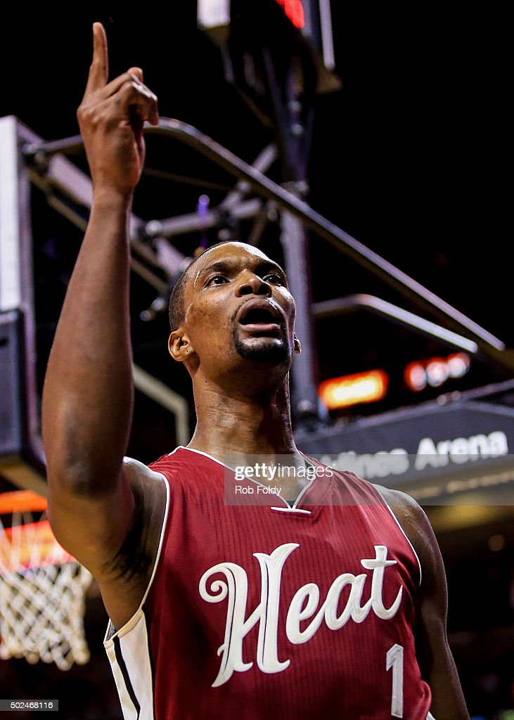 Chris Bosh #1 of the Miami Heat reacts after scoring a basket during overtime of the game against the New Orleans Pelicans at American Airlines Arena on December 25, 2015 in Miami, Florida.