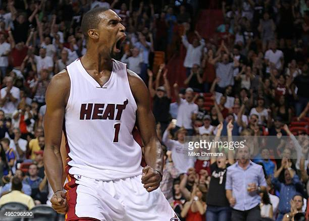 Chris Bosh of the Miami Heat reacts to a play during a game against the Houston Rockets at American Airlines Arena on November 1 2015 in Miami...