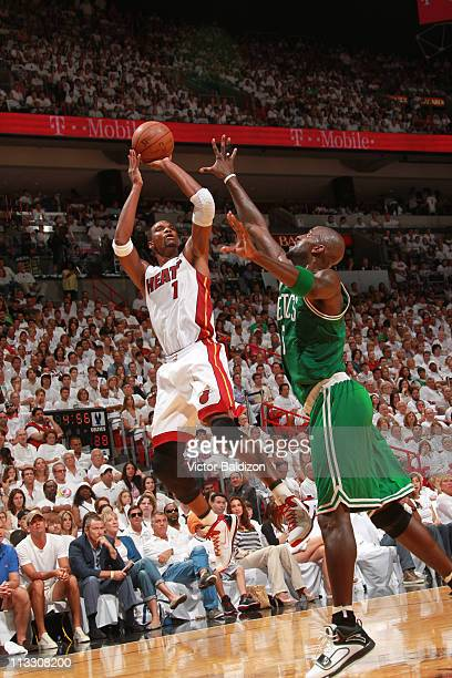 Chris Bosh of the Miami Heat shoots against Kevin Garnett of the Boston Celtics in Game One of the Eastern Conference Semifinals in the 2011 NBA...