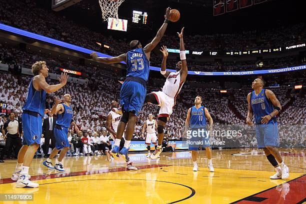 Chris Bosh of the Miami Heat shoots over Brendan Haywood of the Dallas Mavericks in the second half in Game One of the 2011 NBA Finals at American...