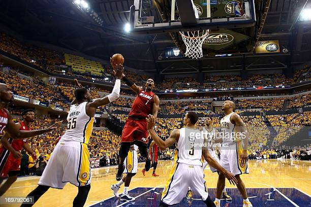 Chris Bosh of the Miami Heat shoots the ball against Roy Hibbert and George Hill of the Indiana Pacers in Game Six of the Eastern Conference Finals...
