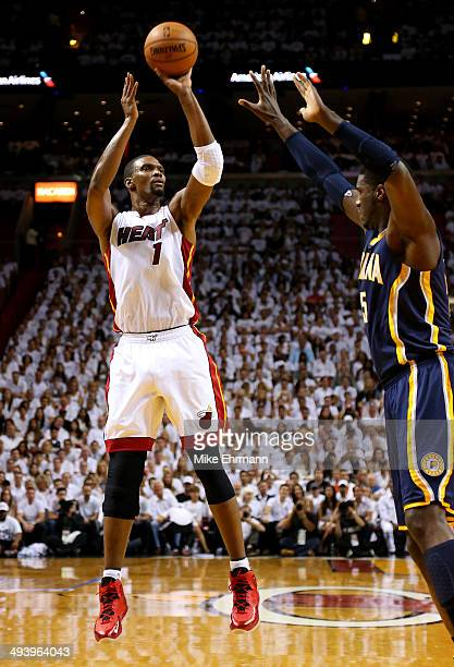 Chris Bosh of the Miami Heat takes a shot as Roy Hibbert of the Indiana Pacers defends during Game Four of the Eastern Conference Finals of the 2014...