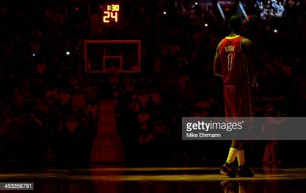 Chris Bosh of the Miami Heat warms up during a game against the Detroit Pistons at American Airlines Arena on December 3 2013 in Miami Florida NOTE...