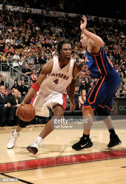 Chris Bosh of the Toronto Raptors drives against David Lee of the New York Knicks during the game on April 5 2009 at Air Canada Centre in Toronto...