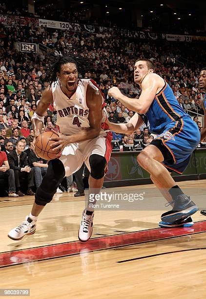 Chris Bosh of the Toronto Raptors drives against Nick Collison of the Oklahoma City Thunder during the game on March 19 2010 at Air Canada Centre in...