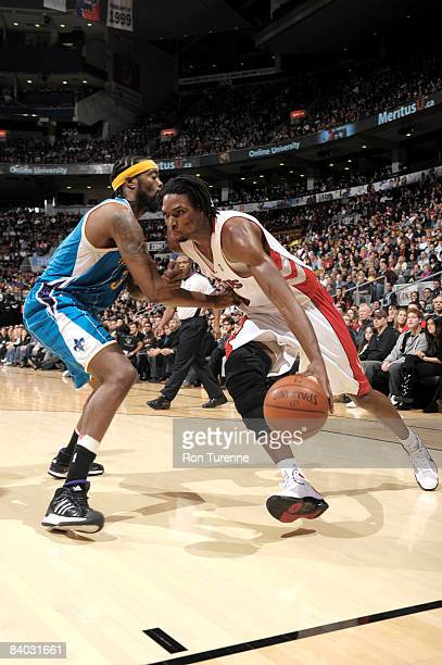 Chris Bosh of the Toronto Raptors drives baseline against Melvin Ely of the New Orleans Hornets on December 14 2008 at the Air Canada Centre in...