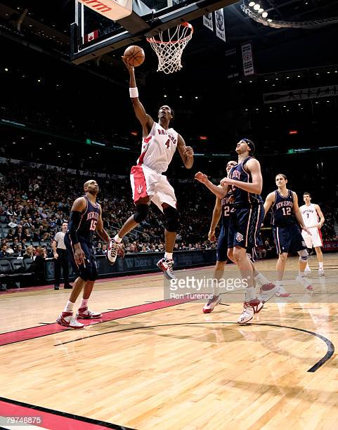 Chris Bosh of the Toronto Raptors drives inside past Josh Boone of the New Jersey Nets on February 13 2008 at the Air Canada Centre in Toronto Canada...