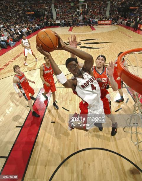 Chris Bosh of the Toronto Raptors drives to the rim past Walter Herrmann of the Charlotte Bobcats January 22 2007 at the Air Canada Centre in Toronto...