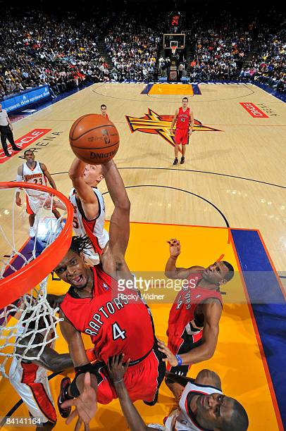 Chris Bosh of the Toronto Raptors dunks the ball against the Golden State Warriors on December 29 2008 at Oracle Arena in Oakland California NOTE TO...
