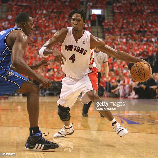 Chris Bosh of the Toronto Raptors goes around Dwight Howard of the Orlando Magic in game 3 of the Eastern Conference quarterfinals on April 24 2008...