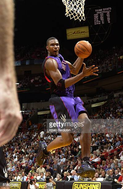 Chris Bosh of the Toronto Raptors grabs a rebound against the Miami Heat on November 30 2004 at American Airlines Arena in Miami Florida NOTE TO USER...