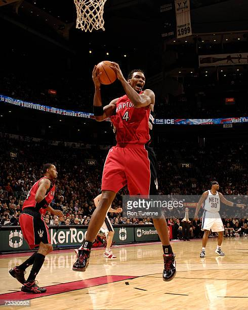 Chris Bosh of the Toronto Raptors grabs a rebound during a game against the New Jersey Nets on February 14 2007 at the Air Canada Centre in Toronto...
