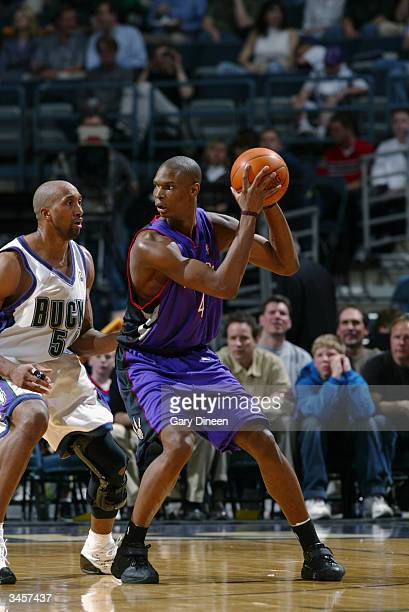 Chris Bosh of the Toronto Raptors is defended by Brian Skinner of the Milwaukee Bucks during the game at Bradley Center on April 14 2004 in Milwaukee...