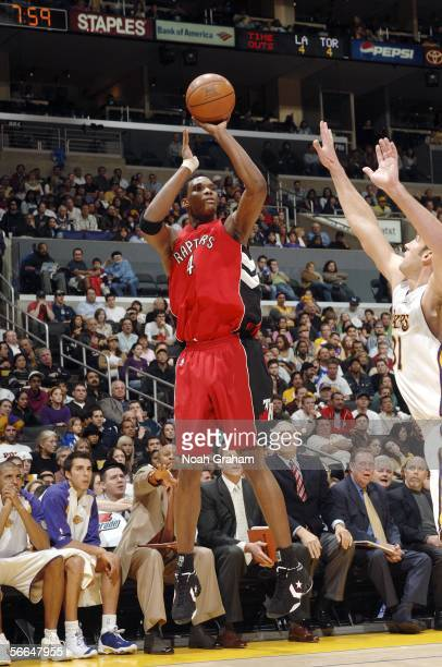 Chris Bosh of the Toronto Raptors puts up a shot against Chris Mihm of the Los Angeles Lakers on January 22 2006 at Staples Center in Los Angeles...