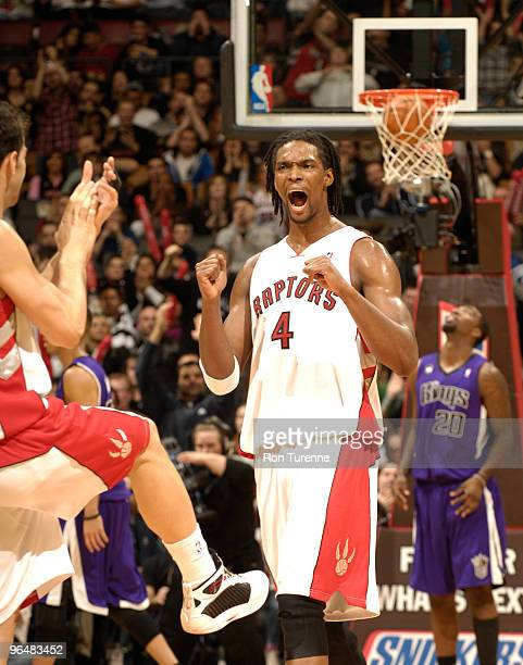 Chris Bosh of the Toronto Raptors reacts after a crucial play late in a game against the Sacramento Kings February 7 2010 at the Air Canada Centre in...