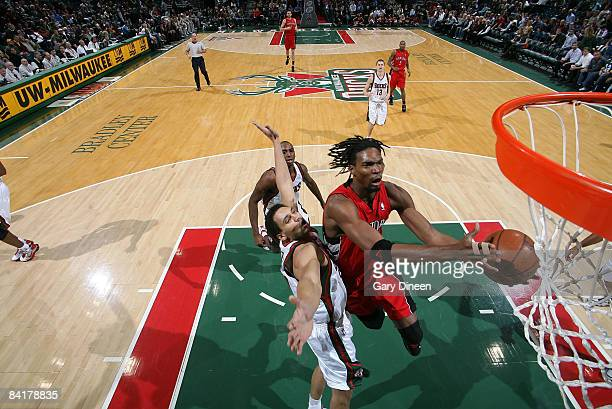 Chris Bosh of the Toronto Raptors shoots a layup against Dan Gadzuric of the Milwaukee Bucks on January 5 2009 at the Bradley Center in Milwaukee...