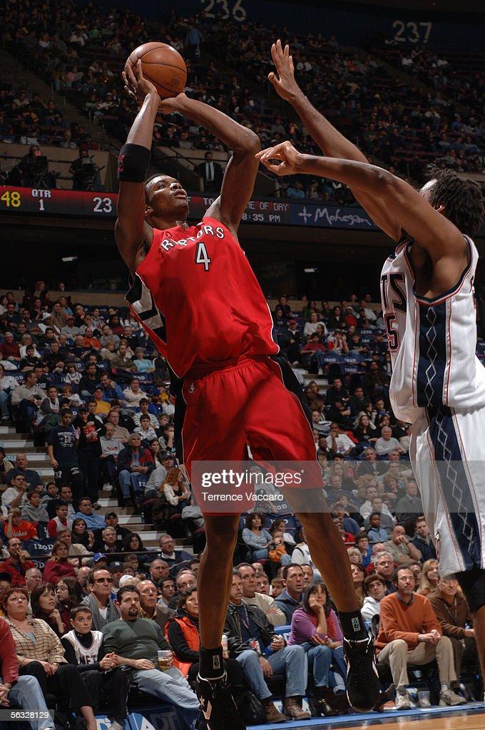 reputable site 6289e 35cd5 Chris Bosh of the Toronto Raptors shoots against Jason ...