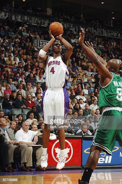Chris Bosh of the Toronto Raptors shoots over Antoine Walker of the Boston Celtics during the game at Air Canada Centre on April 17 2005 in Toronto...