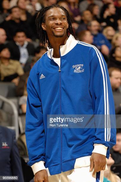 Chris Bosh of the Toronto Raptors smiles during the game against the New Jersey Nets on December 18 2009 at Air Canada Centre in Toronto Canada The...