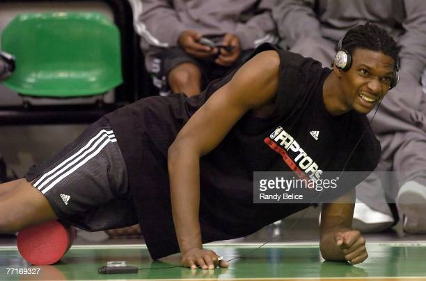 Chris Bosh of the Toronto Raptors stretches prior to the start of practice as part of the 2007 NBA Europe Live Tour on October 3, 2007 at the La...