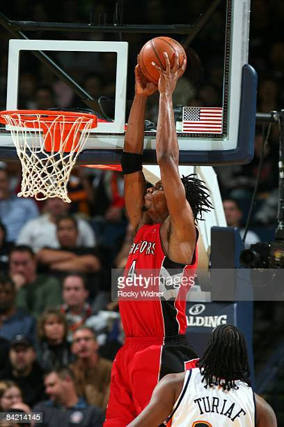 Chris Bosh of the Toronto Raptors takes the ball to the basket against Ronny Turiaf of the Golden State Warriors during the game at Oracle Arena in...