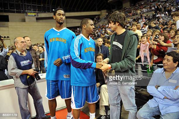 Chris Bosh speaks with Ricky Rubio at the game during the 2008 NBA Europe Live Tour on October 17, 2008 at the Palau Sant Jordi in Barcelona, Spain....