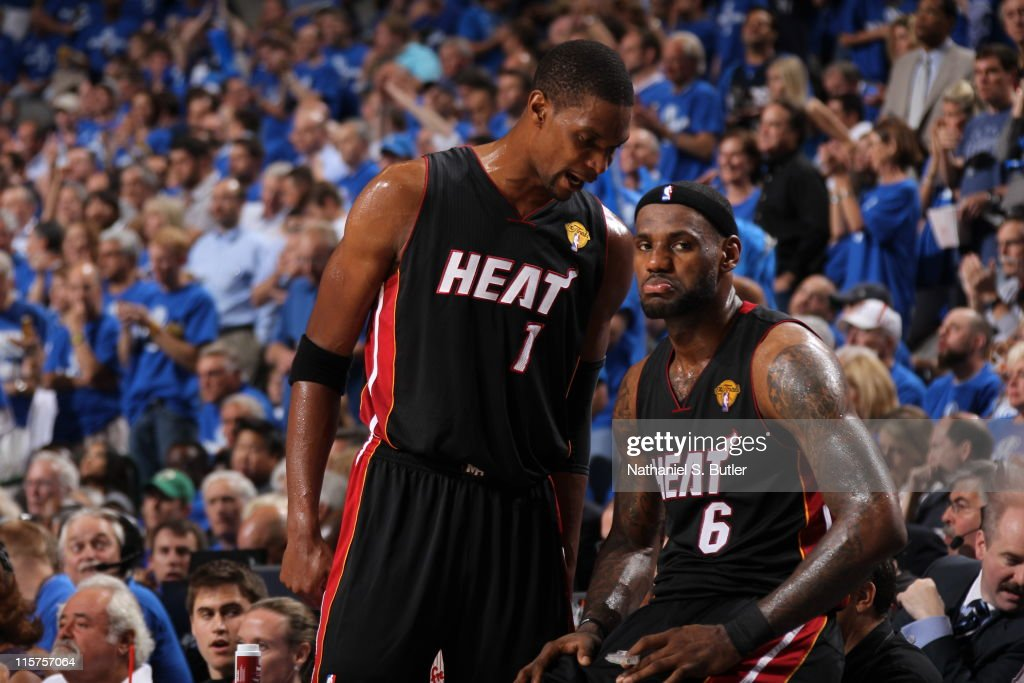 Chris Bosh #1 talks to LeBron James #6 of the Miami Heat during Game Five of the 2011 NBA Finals against the Dallas Mavericks on June 09, 2011 at the American Airlines Center in Dallas, Texas.