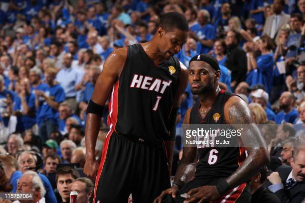 Chris Bosh talks to LeBron James of the Miami Heat during Game Five of the 2011 NBA Finals against the Dallas Mavericks on June 09 2011 at the...