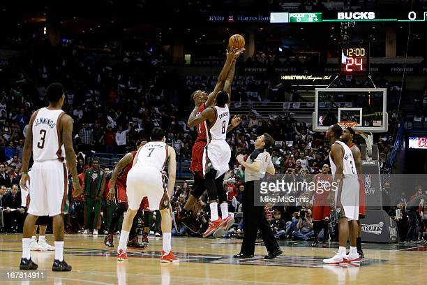 Chris Bosh the Miami Heat goes up for the opening tip against Larry Sanders of the Milwaukee Bucks during Game Three of the Western Conference...