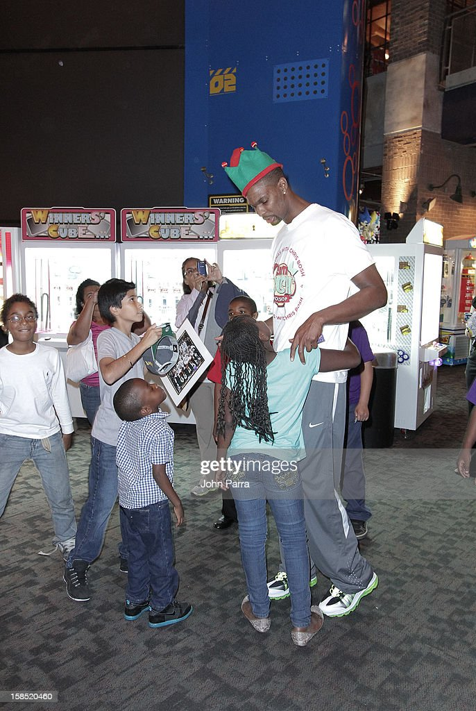 Chris Bosh with the children during the Christmas With Chris Bosh At 'Santa Bosh's Workshop at Game Time at Sunset Place on December 17, 2012 in Miami, Florida.