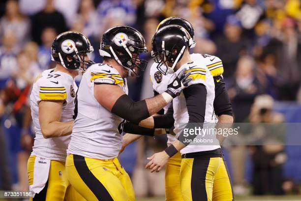 Chris Boswell of the Pittsburgh Steelers celebrates with teammates after kicking a gamewinning field goal against the Indianapolis Colts during the...