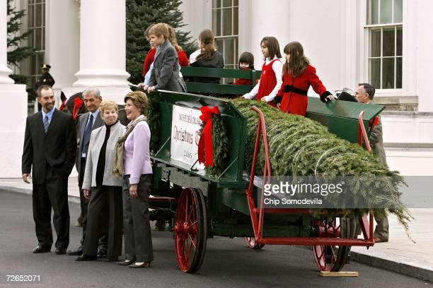Chris Botek and his parents Francis and Margaret Botek of Crystal Spring Tree Farm present US first lady Laura Bush with the National Christmas Tree...