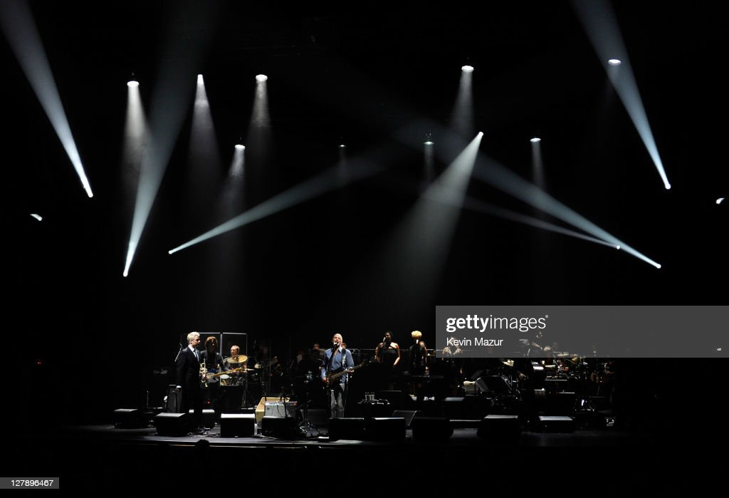 Chris Botti and Sting perform on stage during