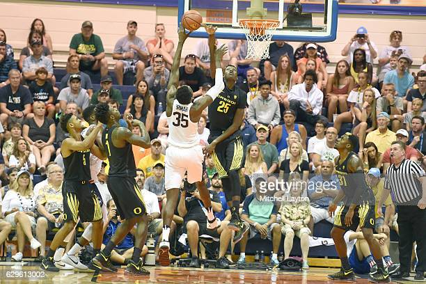 Chris Boucher of the Oregon Ducks blocks a shot by Amida Brimah of the Connecticut Huskies during the Maui Invitation college basketball tournament...